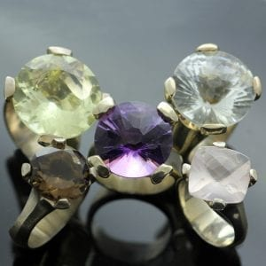 Cocktail rings set with precious gemstones