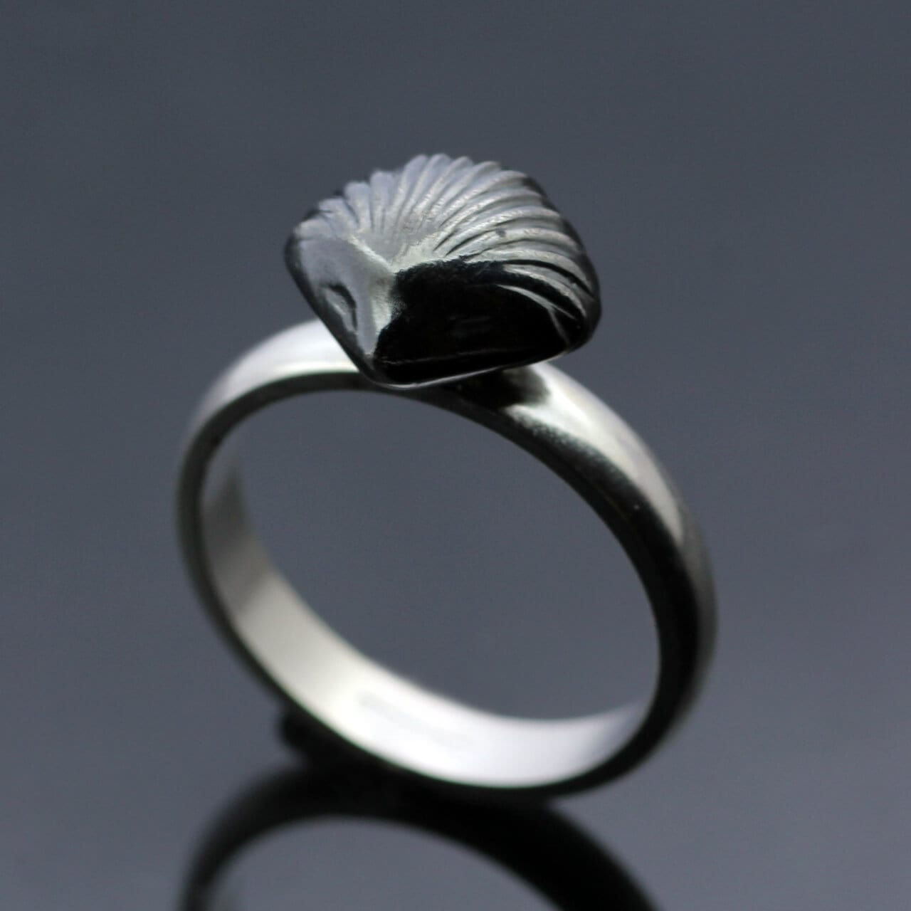 Modern solid Silver ring with oxidised handmade shell fossil charm