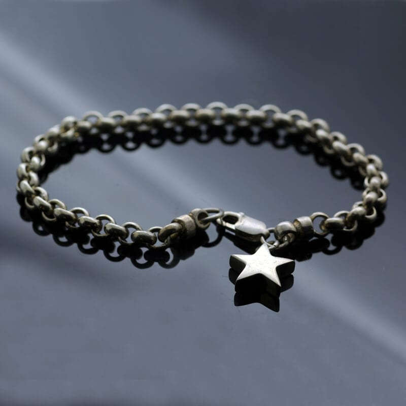Handmade solid Silver hallmarked bracelet with Silver Star charm