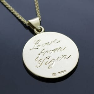 Hand engraved bespoke yellow gold pendant by Julian Stephens