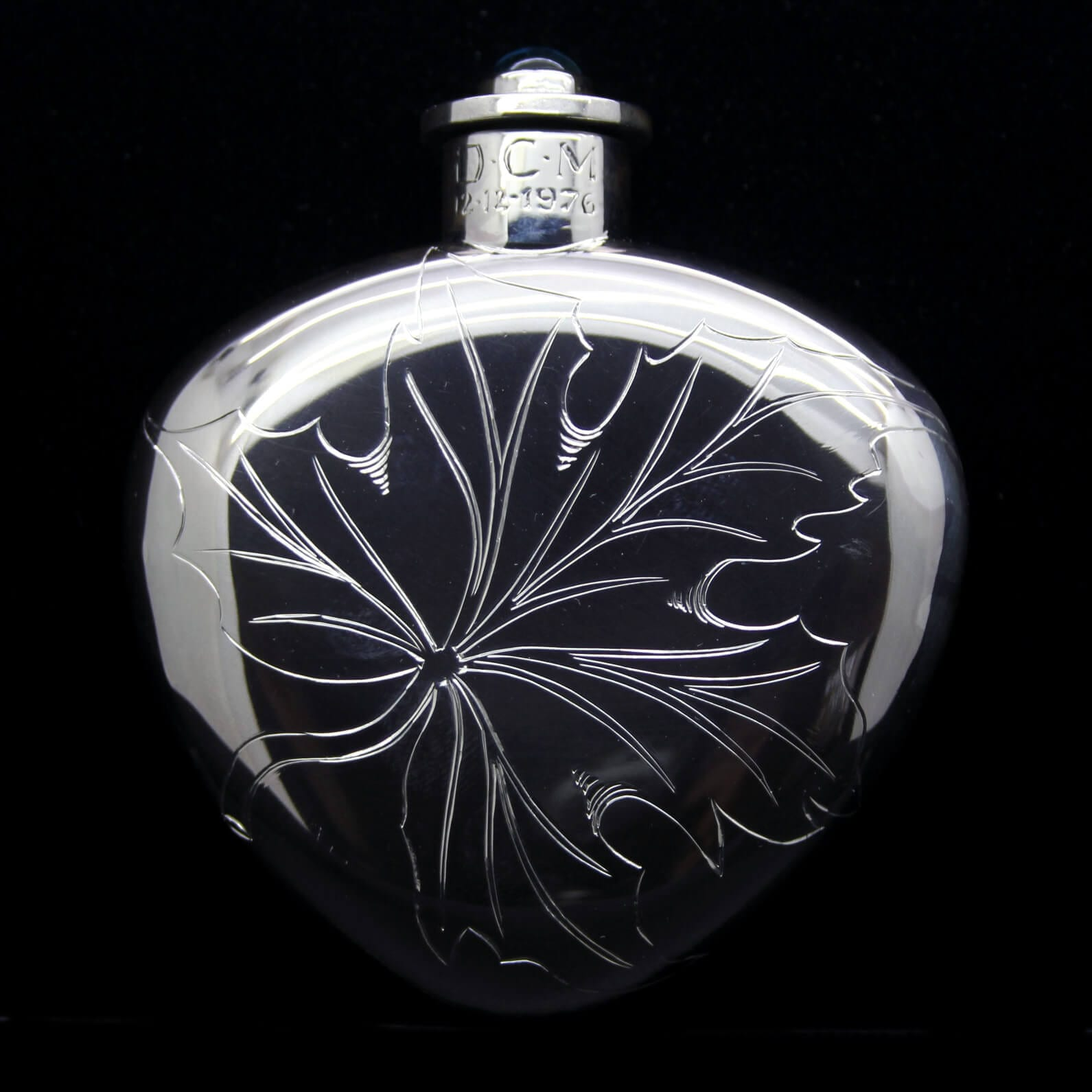 Handmade solid Silver hipflask with engraved design by Julian Stephens