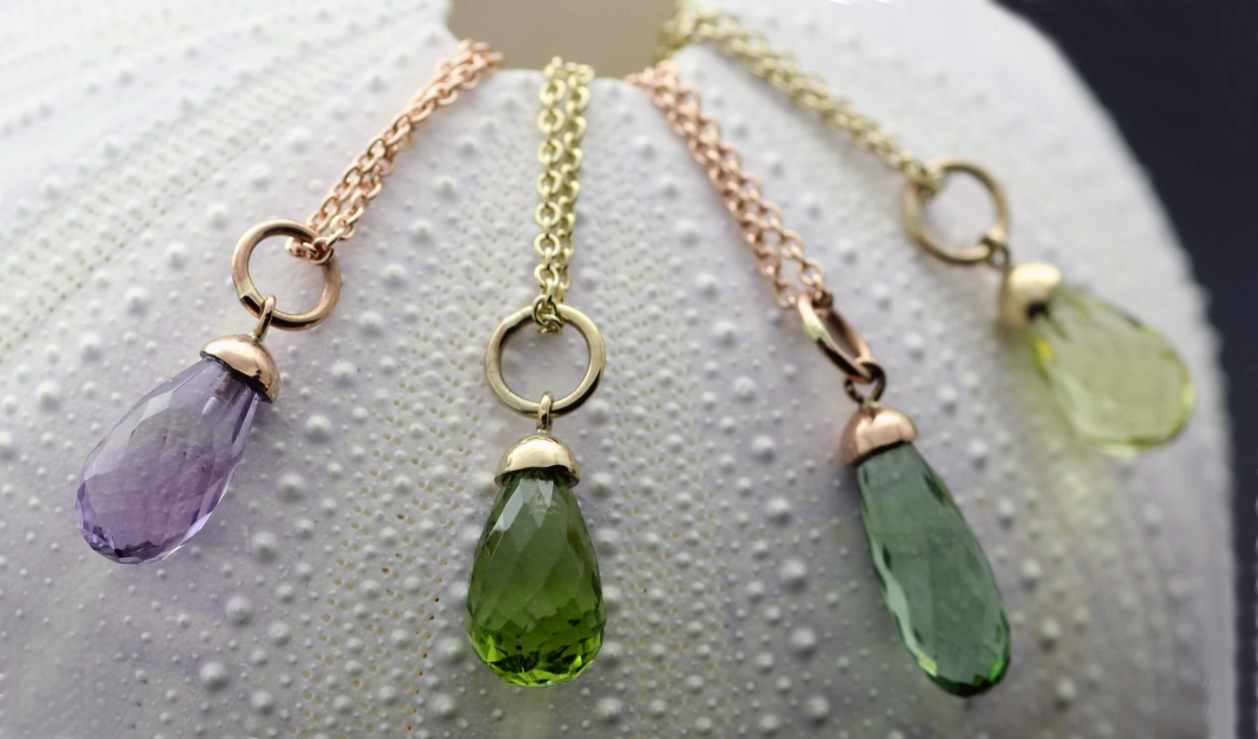 Briolette cut gemstones set in Rose Gold and Yellow Gold necklaces