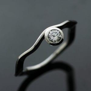 Unique and contemporary Solitaire Diamond engagement ring