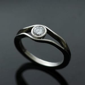 Contemporary Solitaire Diamond and Platinum handcrafted engagement ring