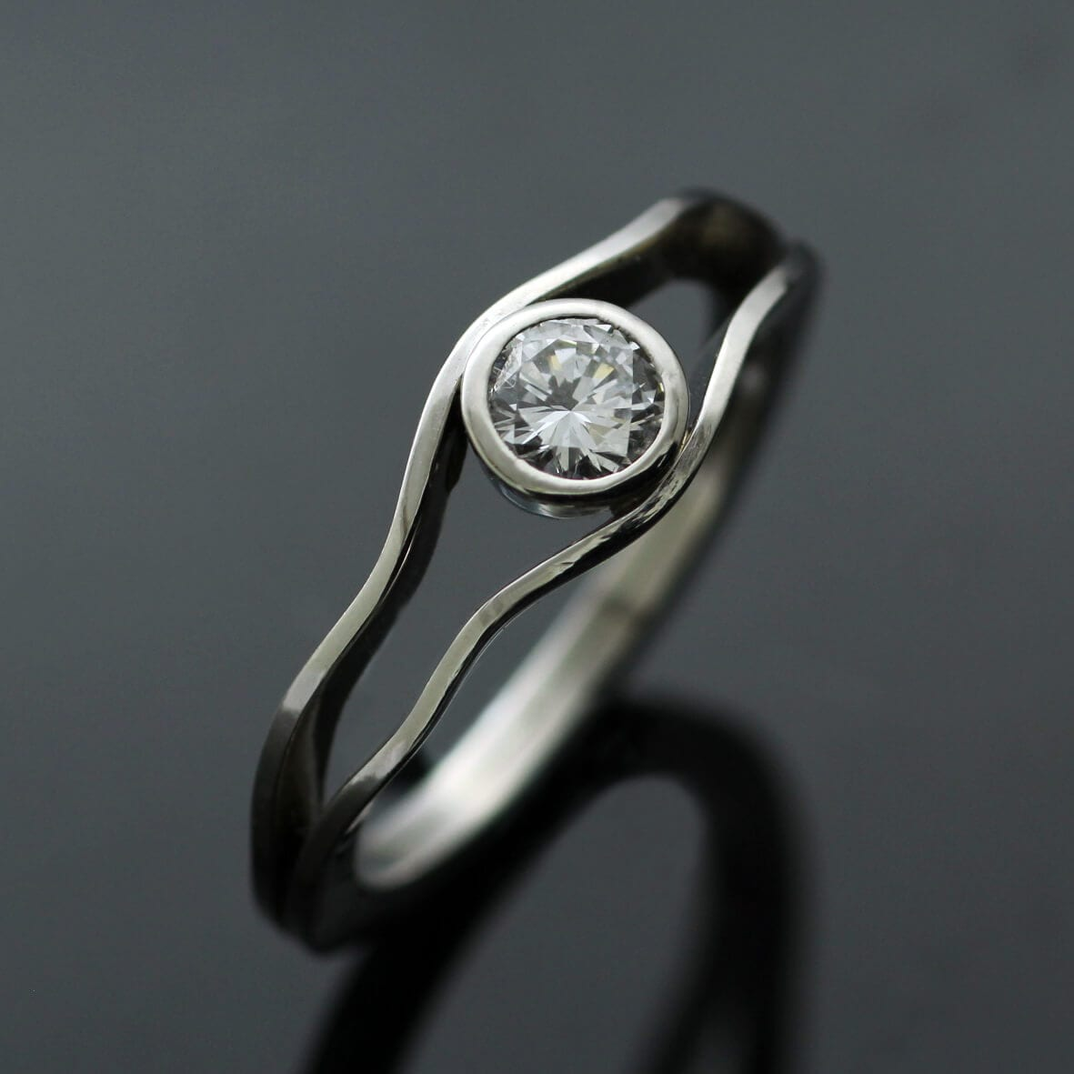 Contemporary Solitaire Diamond and Platinum engagement ring