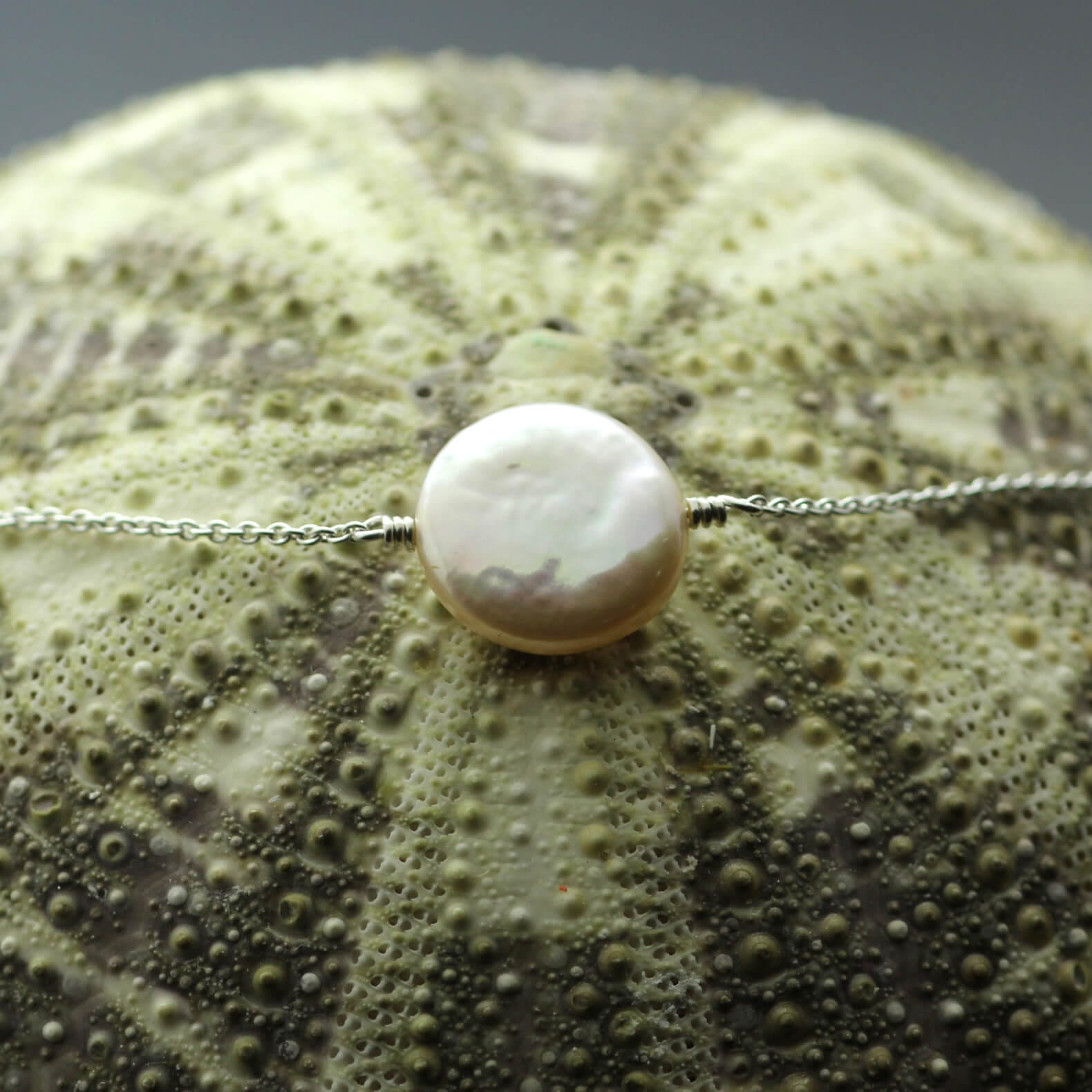 Handcrafted modern Silver button Pearl bracelet