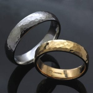 Matching handmade 22ct Yellow Gold and Palladium wedding bands with textured finish