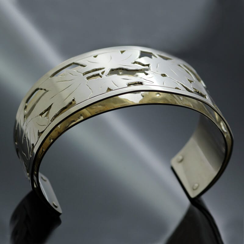 Contemporary fine jewellery featuring Yellow Gold Sterling Silver hand pierced fret work