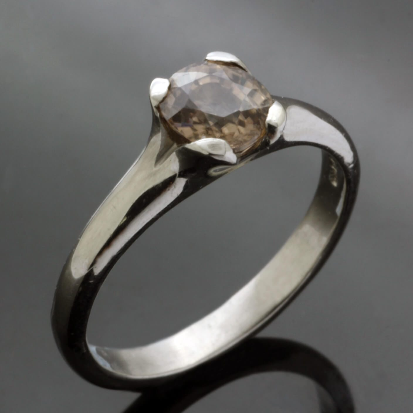 Unconventional engagement ring with natural Zircon gemstone by Julian Stephens