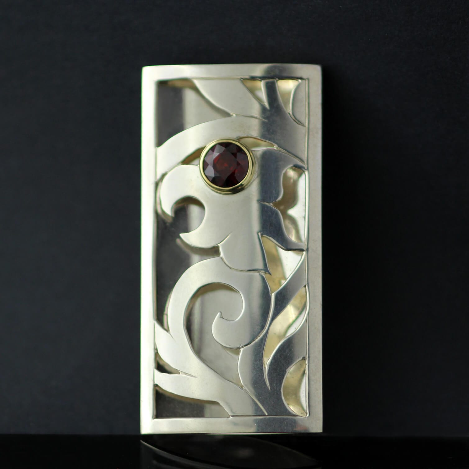 Handmade Sterling Silver Yellow Gold layered hand pierced brooch with Round Brilliant Garnet gemstone