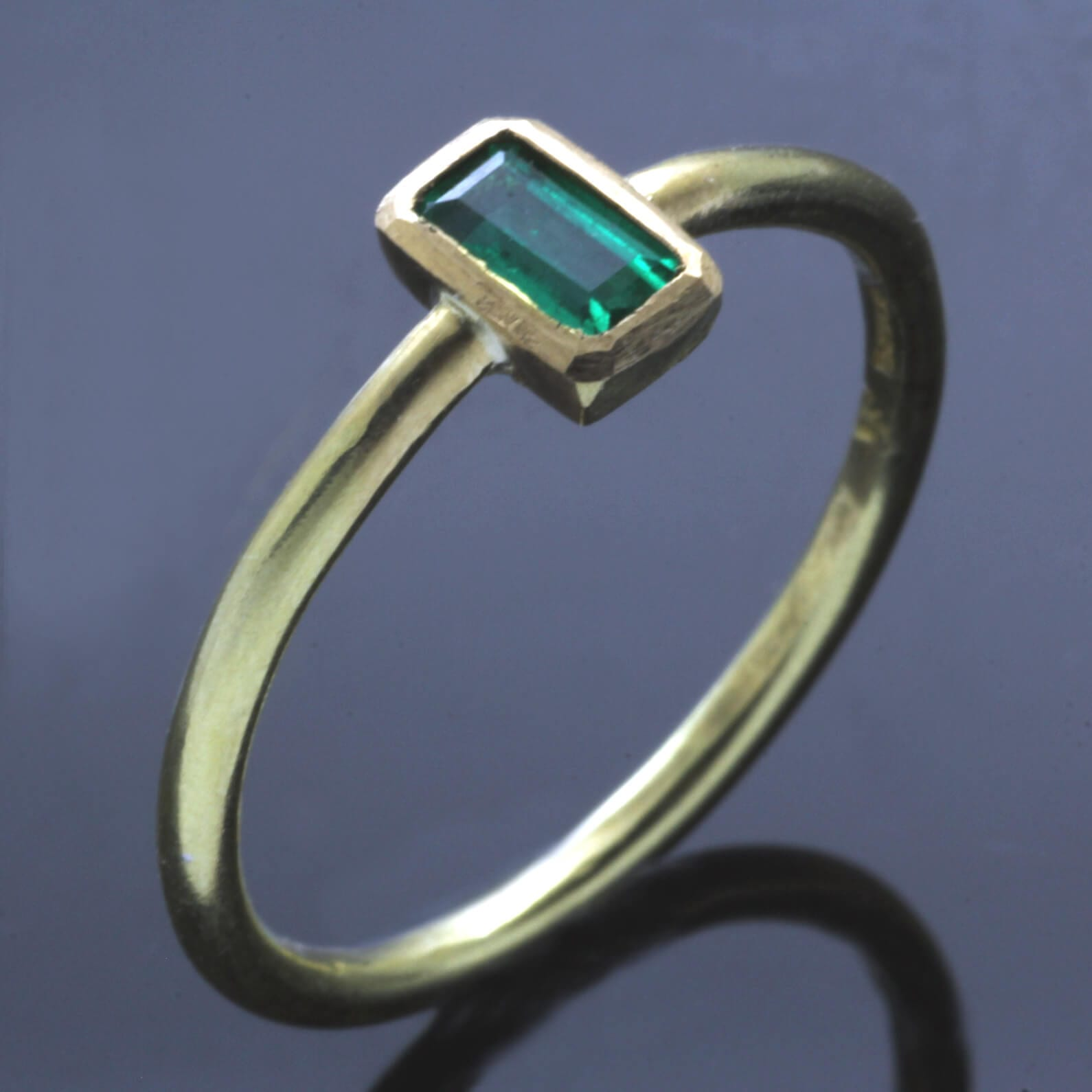 Modern stacking ring handmade in Yellow Gold with Baguette cut Emerald gemstone