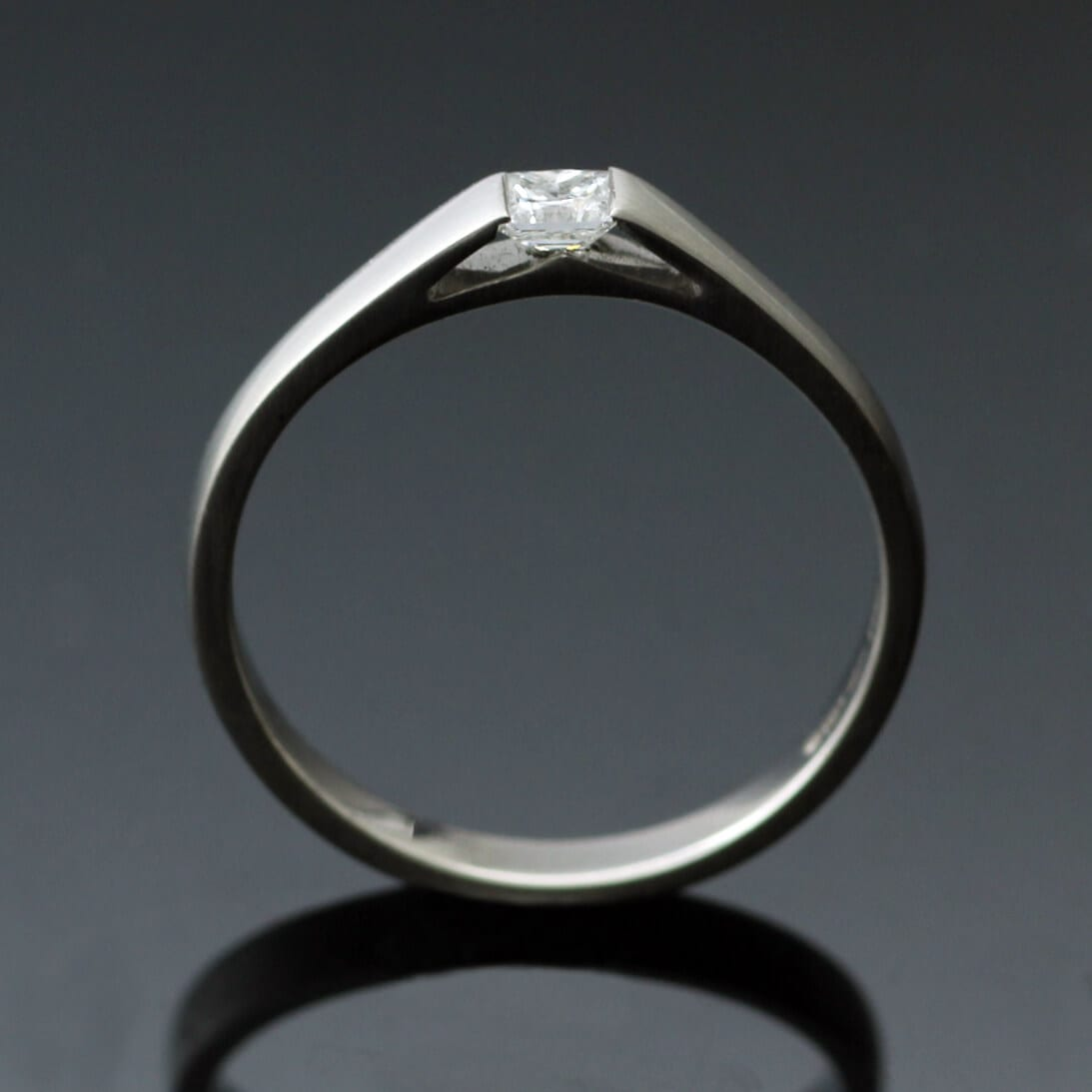 Contemporary Platinum and Diamond engagement ring by Julian Stephens