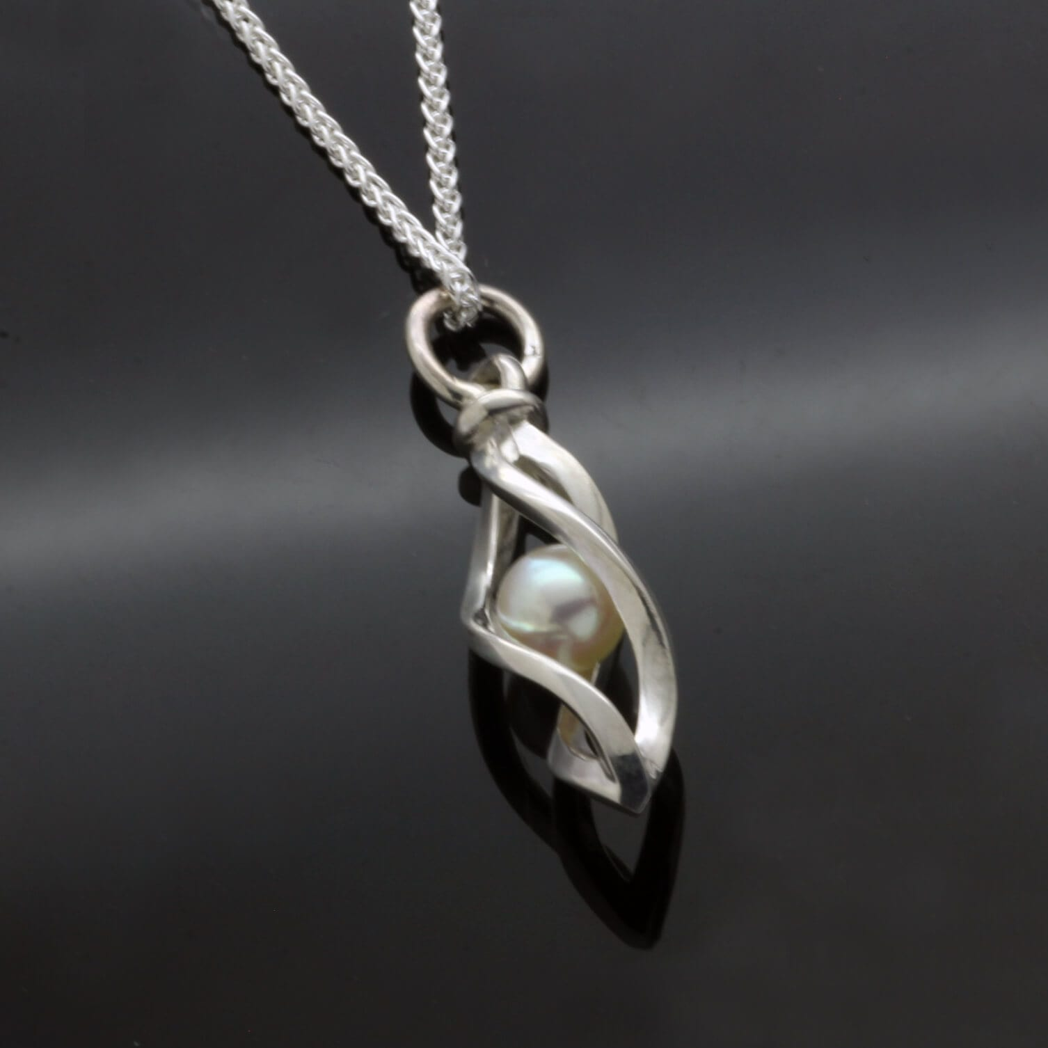 Unique contemporary sculptural jewellery featuring handmade Pearl Silver necklace