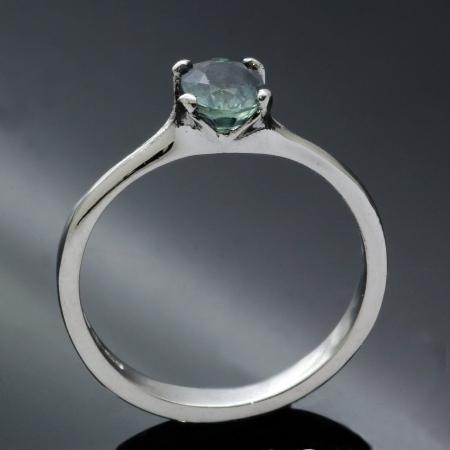 Teal colour change Sapphire set in Platinum engagement ring