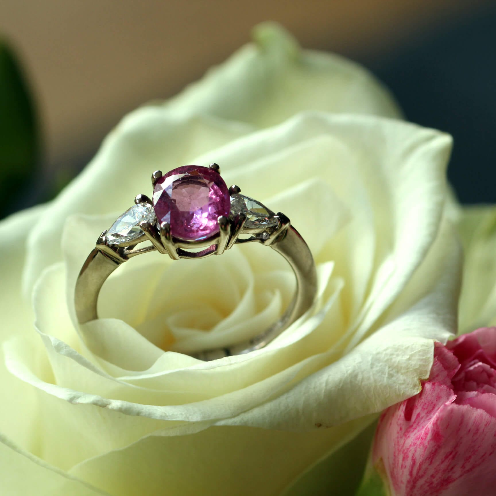 Pink Sapphire and pear cut Diamond engagement ring