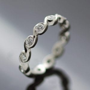 Bespoke eternity band modern wave design platinum diamonds