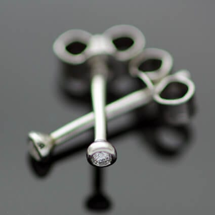 Handmade unique modern diamond platinum stud earrings