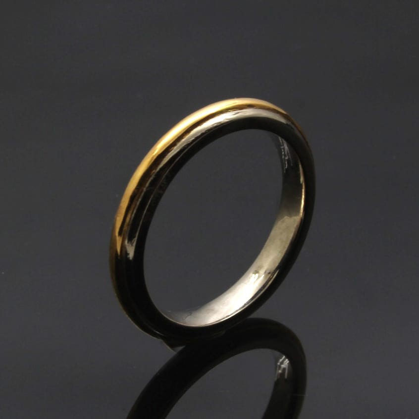 Handmade Yellow Gold and White Gold wedding band by Julian Stephens