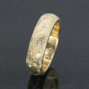 Solid Yellow Gold bespoke Court wedding band with hand engraved pattern and Diamonds