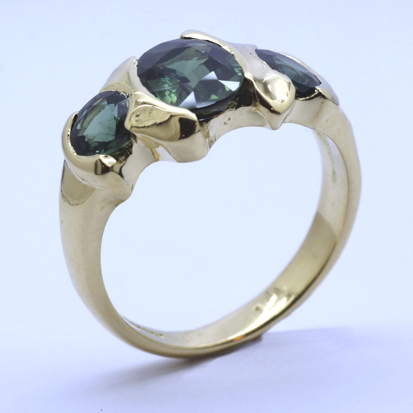 Trilogy Green Sapphires and Yellow Gold