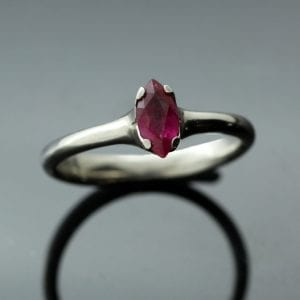 Marquis cut Ruby Flower engagement ring, crafted by Julian Stephens