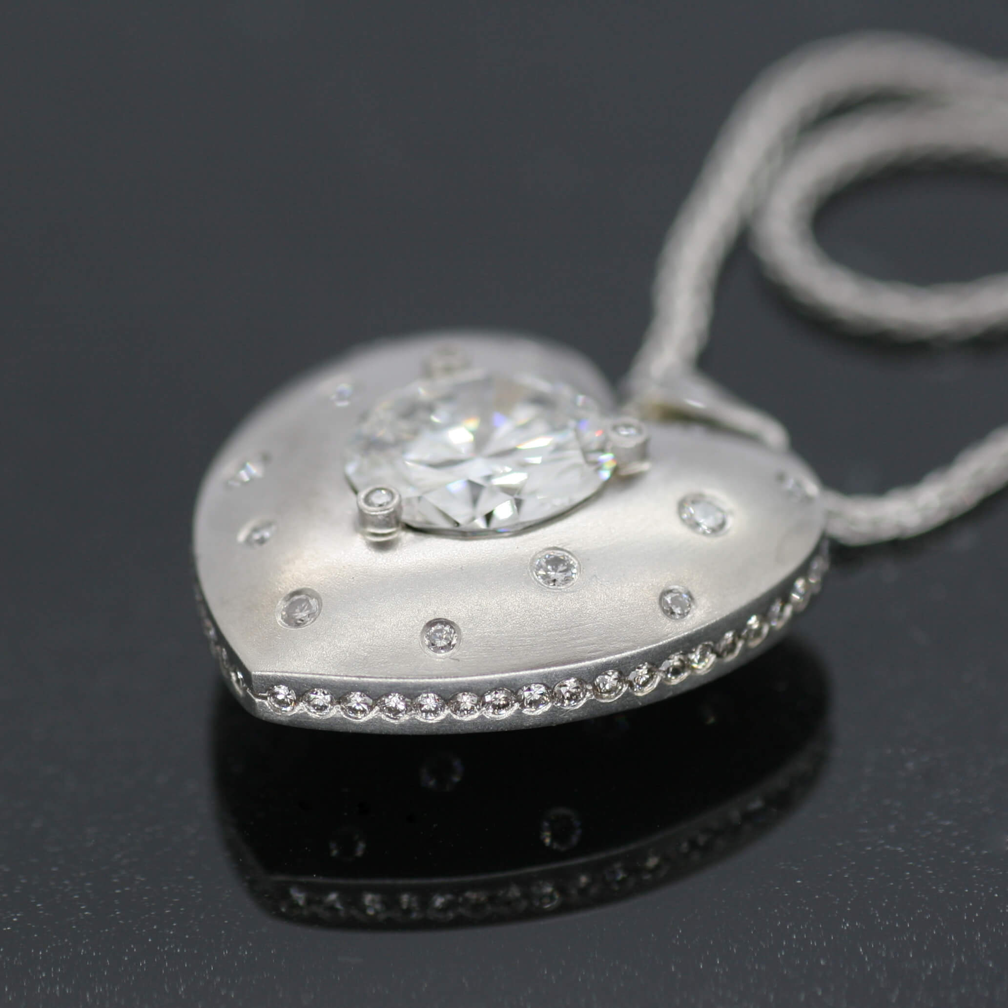Bespoke Platinum and Diamond heart necklace on Platinum chain