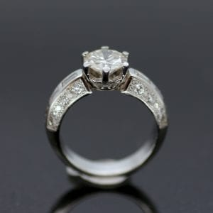 Round brilliant Diamond with twin shoulders of baguette cut Diamonds set in solid Platinum engagement ring