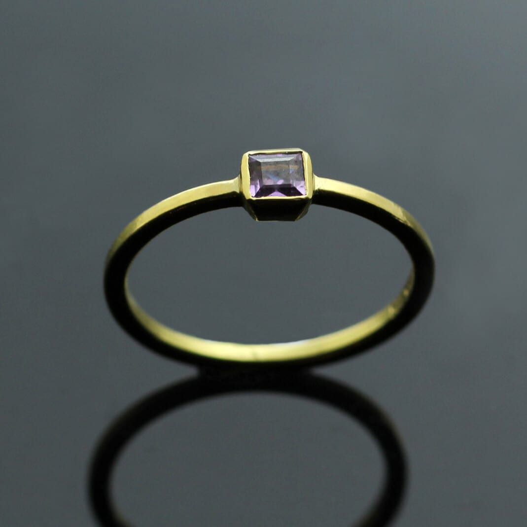 Modern stacking ring with square cut Purple Sapphire gem in Yellow Gold