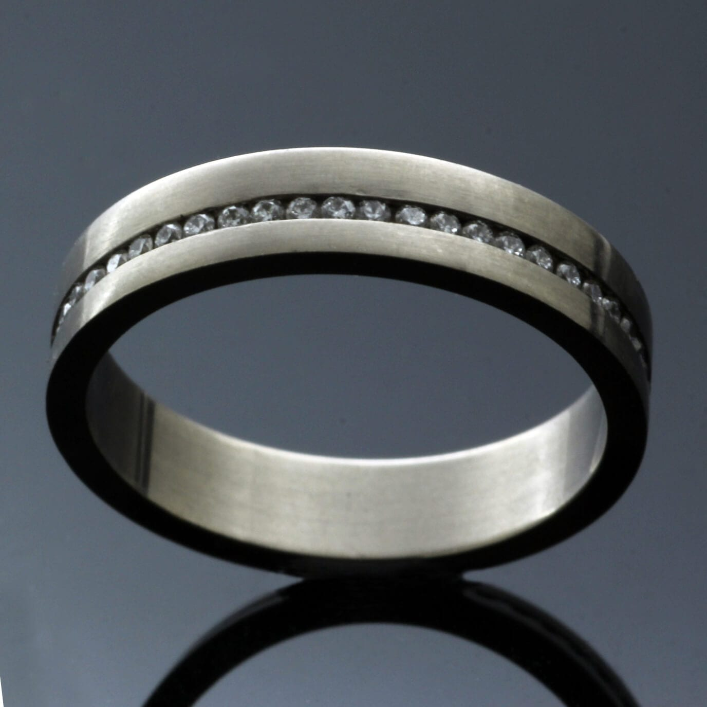 Contemporary handcrafted white gold diamond eternity band unique design