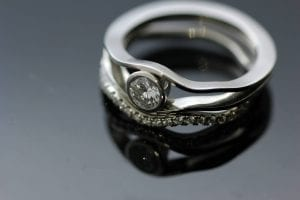 Modern, handcrafted Diamond and Platinum stacking rings by Julian Stephens