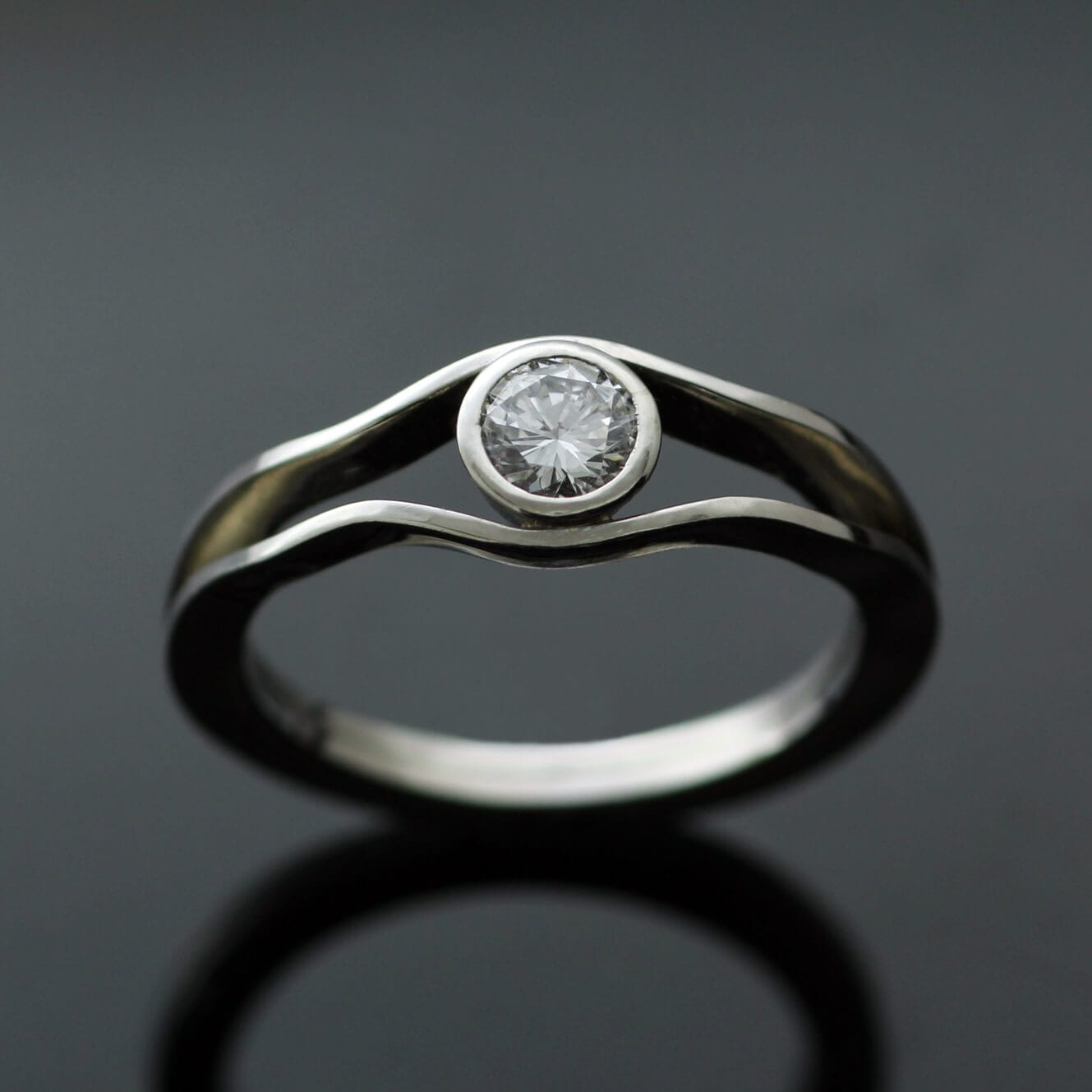 Handmade Platinum and 0.35ct Solitaire Diamond modern engagement ring