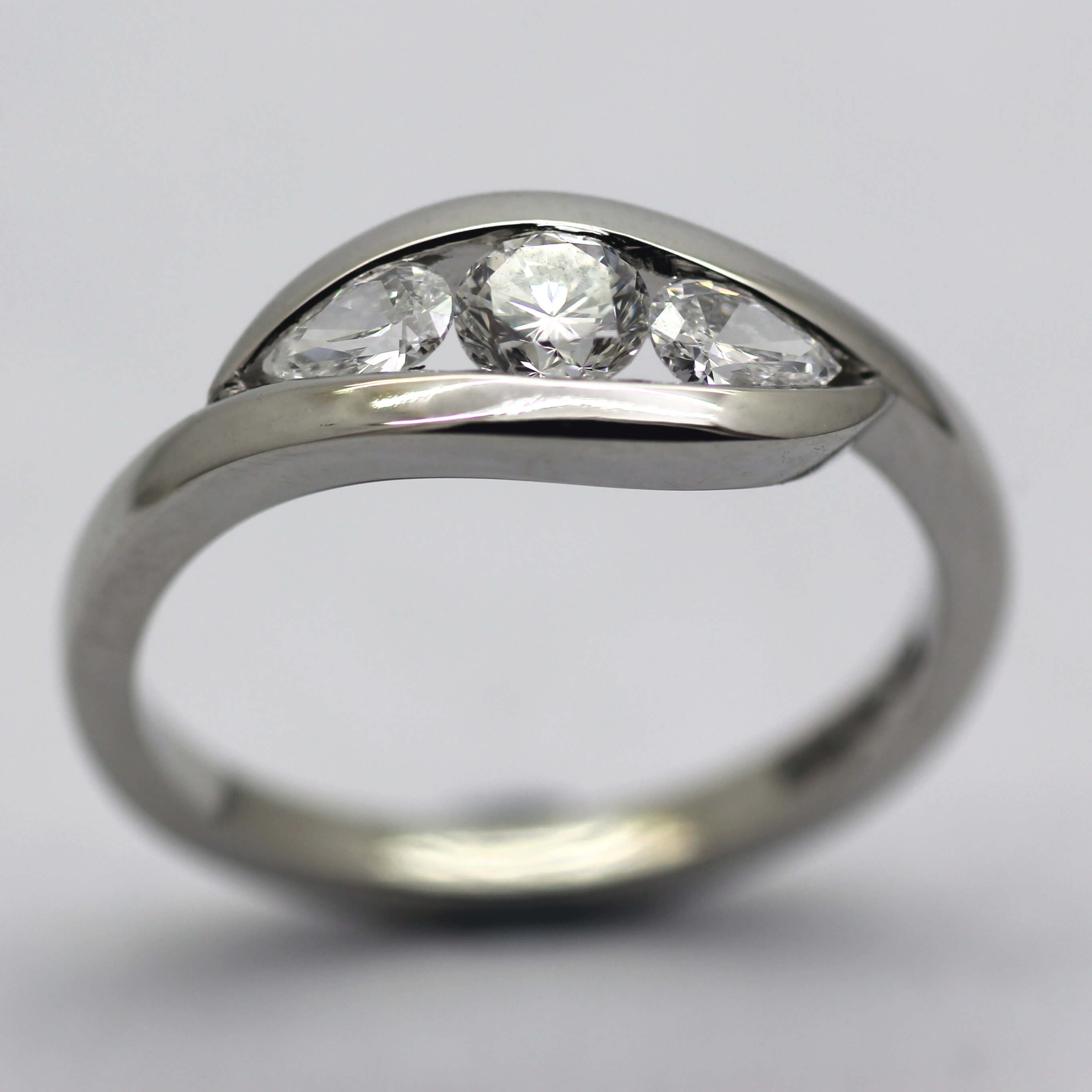 Bespoke handmade modern Diamond and Platinum engagement ring by Julian Stephens Goldsmith