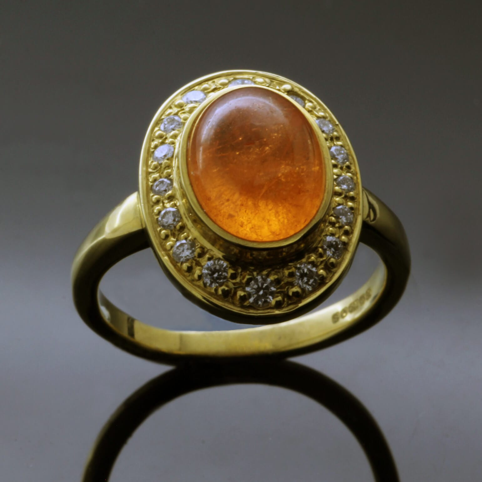 Contemporary Mandarin Garnet pave set Halo Diamonds Yellow Gold statement ring