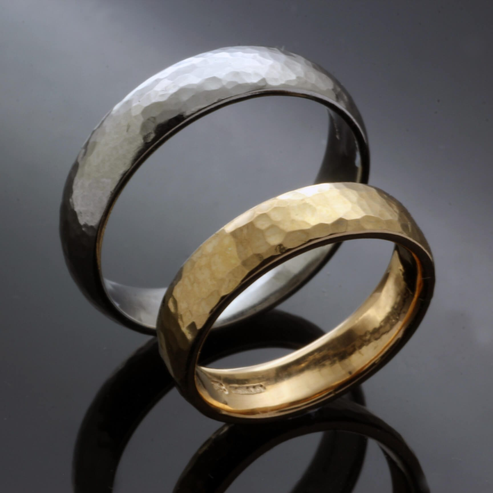 Bespoke textured matching wedding bands in palladium and 22ct Yellow Gold