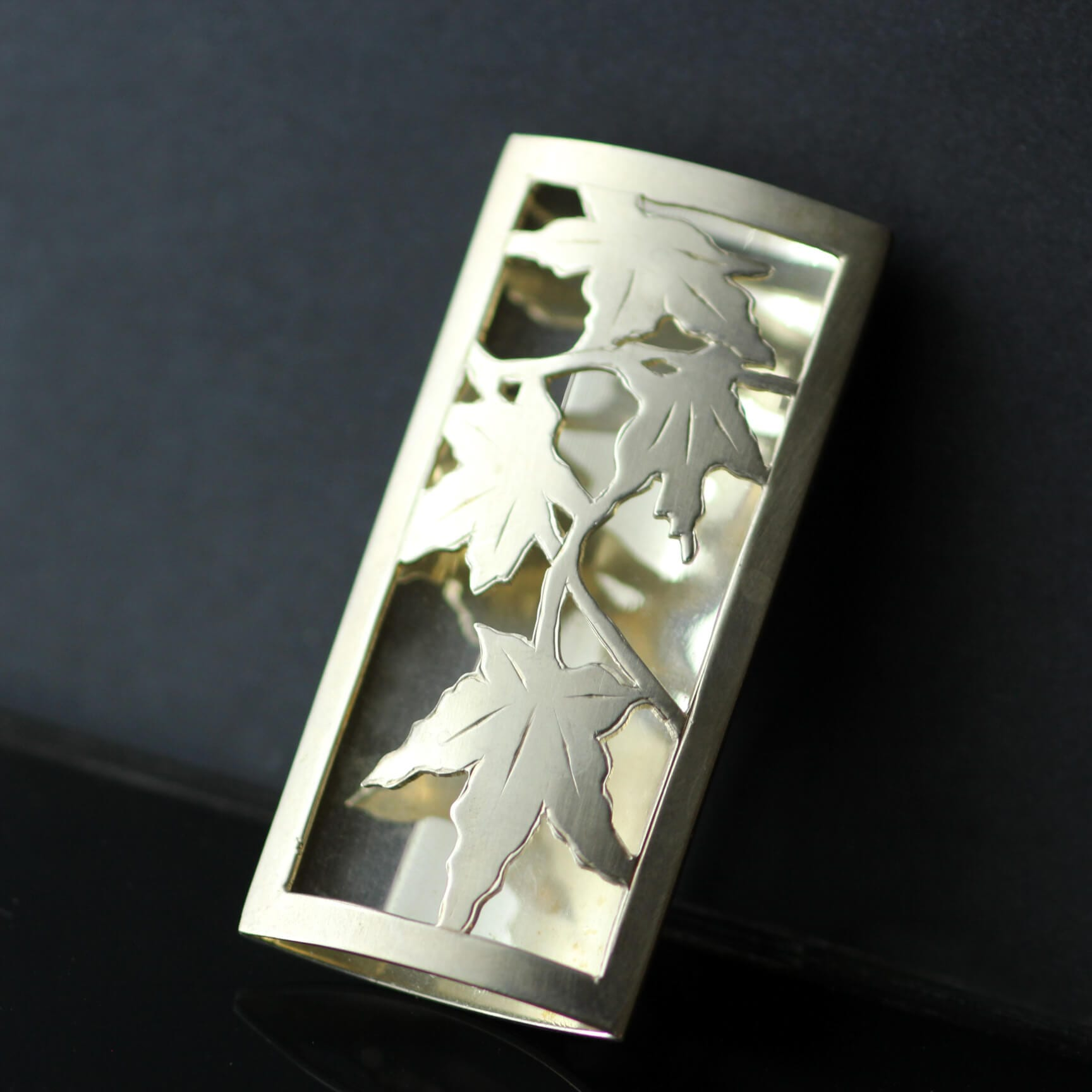 Contemporary jewellery design autumn leaf brooch yellow gold sterling silver