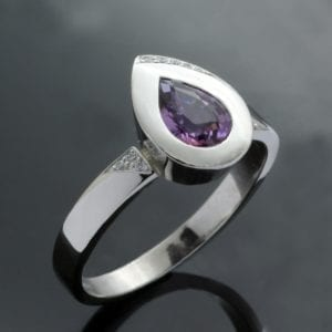 Platinum handmade contemporary ring with Pear cut Purple Sapphire gemstone