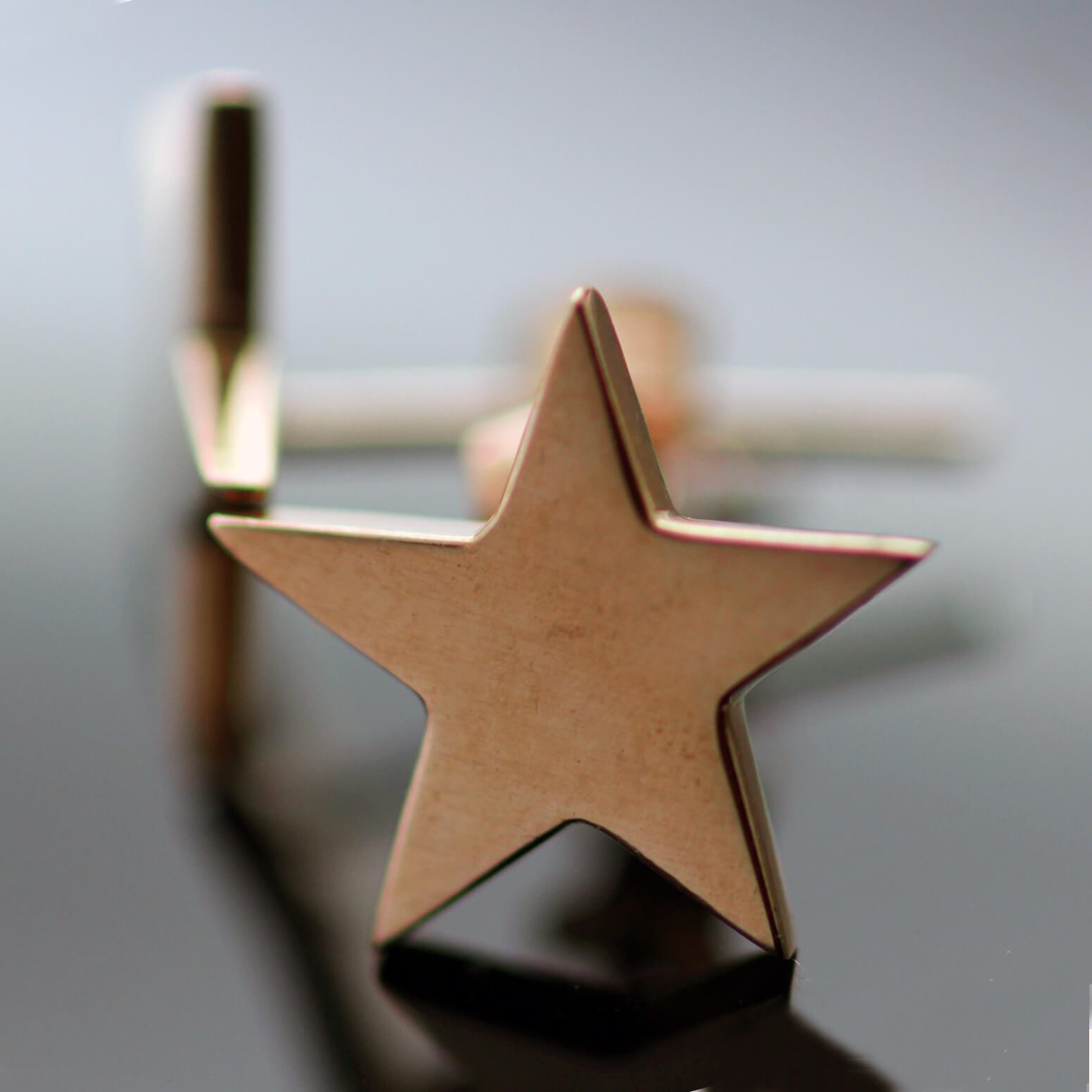Modern solid 9ct rose gold star earrings handcrafted