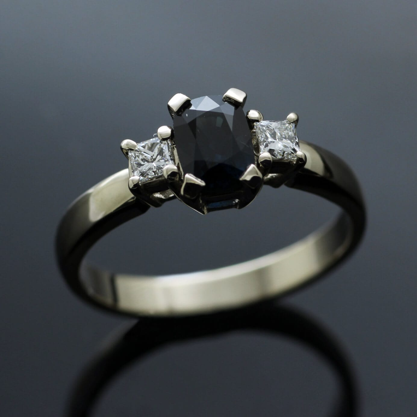 Bespoke contemporary Trilogy ring with Sapphire and twin Princess cut Diamonds