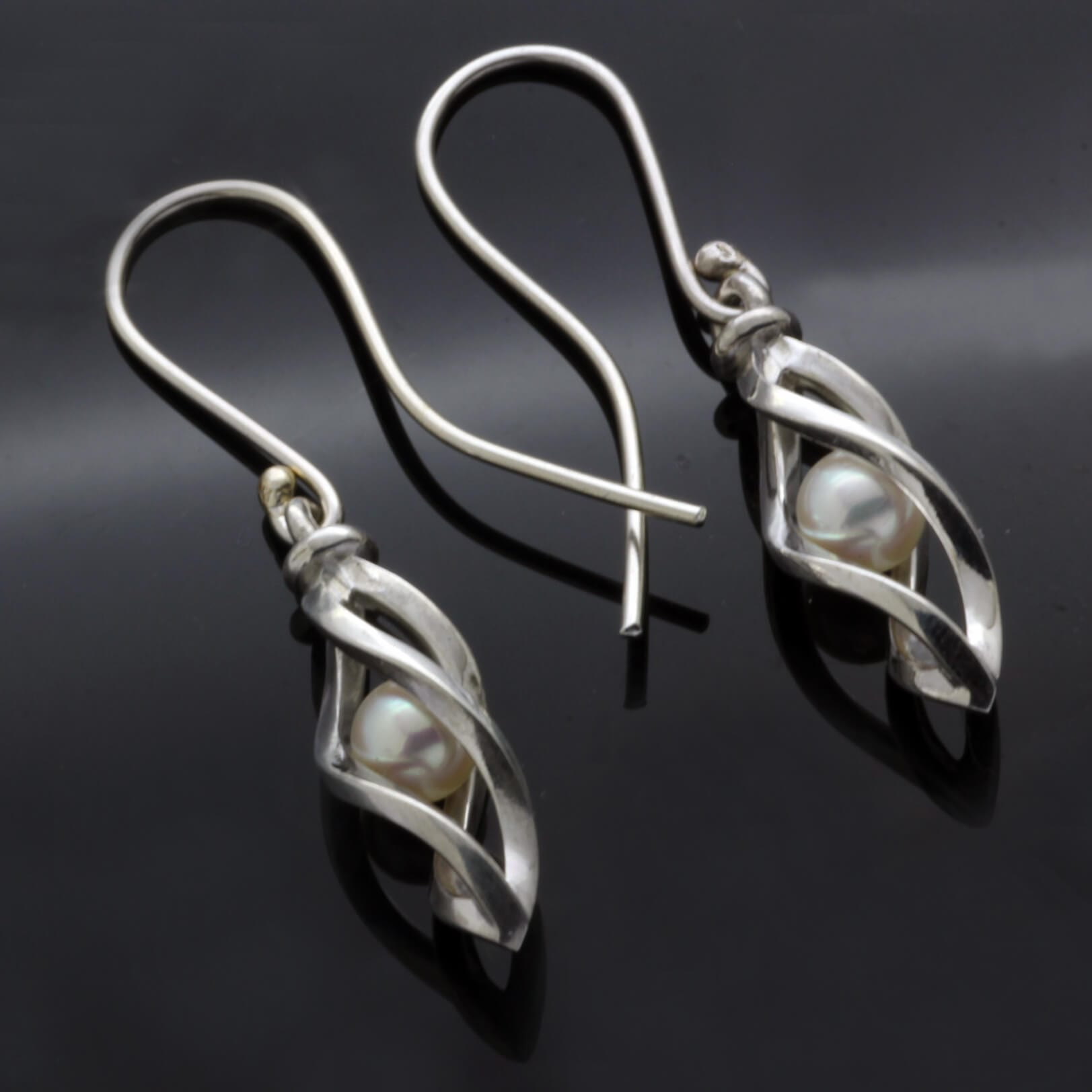 Unique quirky Pearl Silver earrings handmade by Julian Stephens