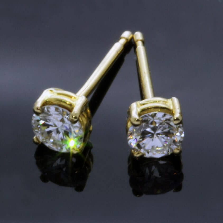 Stylish modern Diamond 18ct Yellow Gold stud earrings