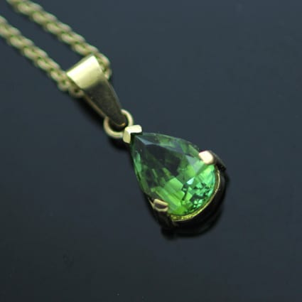 Pear cut lime green tourmaline set in solid 18ct yellow gold