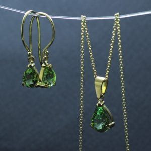 Pear cut green tourmaline yellow gold handcrafted fine jewellery