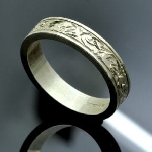 Hand engraved solid sterling silver flat band