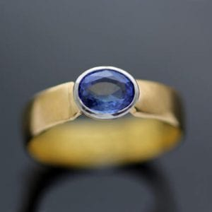 Oval cut Sapphire set in 22ct Yellow gold handmade modern ring