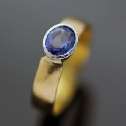 Bespoke handcrafted cocktail ring oval cut sapphire yellow gold