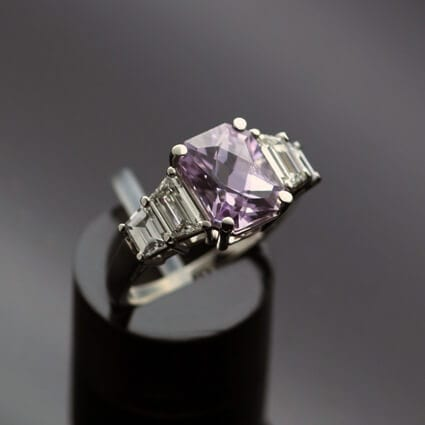 Unique bespoke modern trilogy ring Madagascan lilac sapphire diamonds platinum