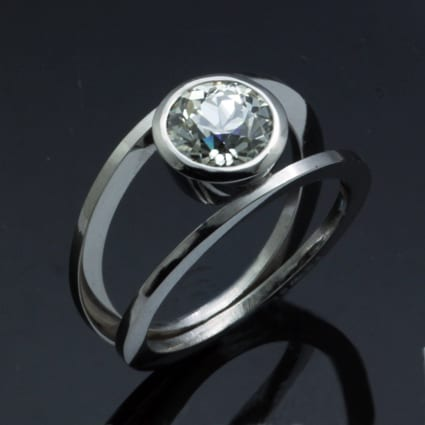 Contemporary handmade platinum round brilliant diamond ring